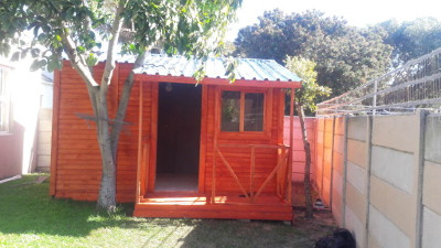 Neat traditional overlapped wendy house with veranda